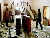 Iraqis loot the German Embassy in Baghdad on 10 April