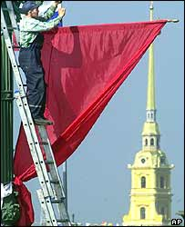 A man putting up a banner