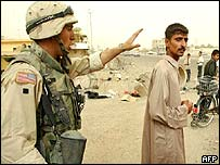 US soldier waves away Iraqi man on outskirts of Baghdad