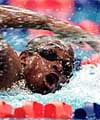 Eric Moussambani ploughs through the water in the 2000 Olympics