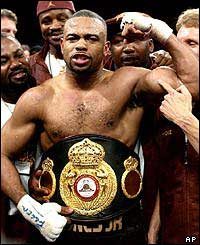 Roy Jones Jr. celebrates after defeating John Ruiz in their WBA Heavyweight Championship bout, Saturday night, March 1, 2003, in Las Vegas.