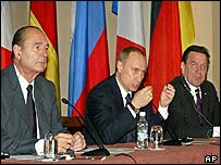 Jacques Chirac, left, Vladimir Putin and Gerhard Schroeder