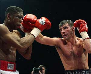 Calzaghe of Wales (right) beats Charles Brewer of the USA to retain his WBO Super-Middleweight title in Cardiff