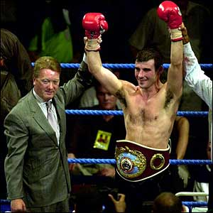 WBO Super-Middleweight Champion Joe Calzaghe with promoter Frank Warren (left) after retaining his belt by defeating Omar Sheika
