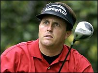 Phil Mickelson follows the flight of his ball