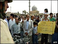 Iraqis protest in front of US forces