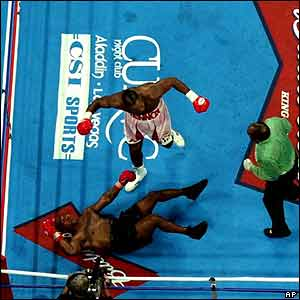 Tyson lying on the floor after a knock-out by Lewis