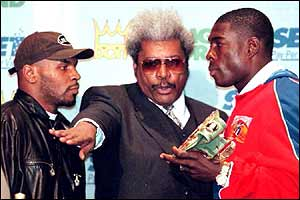 Tyson intimidates Frank Bruno at the weigh-in before their fight in 1996