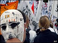 Striking teachers in Paris wearing masks on backs of their heads