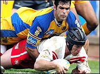 St Helens' Darren Smith scores past Leeds' Chris McKenna