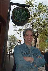 Montreal computer programmer Matthew outside a marijuana supplies shop