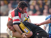 Mefin Davies is driven back by Wasps flanker Joe Worsley