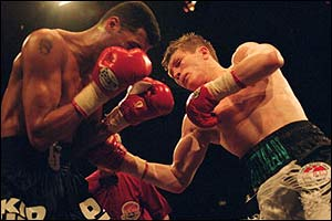 Ricky Hatton of England lands a punch on opponent Tony Pep of Canada during the WBU Light-Welterweight title fight in 2001