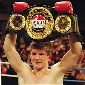 Ricky Hatton of England holds up the WBU Light-Welterweight belt after defeating Canada's Tony Pep