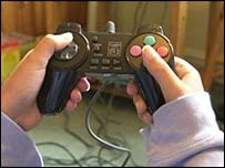 Teenager playing console game, BBC