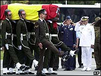 Soldiers carry coffins of comrades who died last May in airplane crash over Turkey