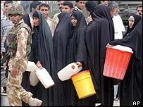 Women in Basra queue for water