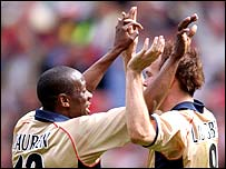 Lauren celebrates with Ljungberg