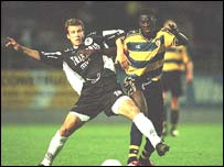 Toure and Eendracht Aalst's Damir Stojak battle for the ball