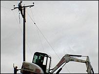 Workmen installing lines