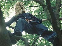 Young girl climbing a tree, BBC