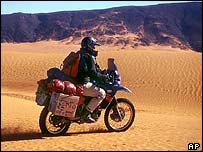Motorcyling tourist in Algerian Sahara