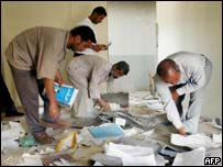 Teachers at Basra University clear up after looting at the campus