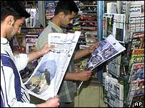 Syrians reading Iraqi news