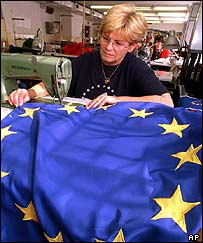 Budapest factory worker sews stars on flag