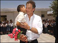 Mr Blair is kissed by a pupil from a school in Basra