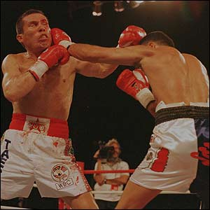 Oscar De La Hoya delivers a left punch during his WBC Super Lightweight title bout versus Julio Cesar Chavez