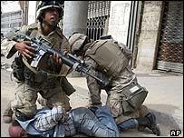 US troops restrain a man in Iraq