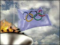 The Olympic flag and flame