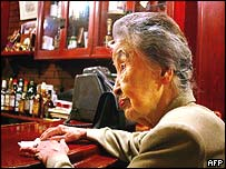 Hideko Arima, 101-year-old bar proprietress, waits for customers at her tiny bar Gilbey-A