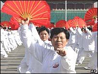 Chinese perform an ancient martial art form with fans