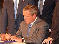 President Bush signing his tax cutting bill
