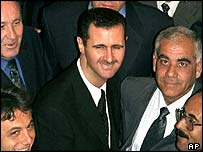 Assad surrounded by members of the Syrian Baath Party