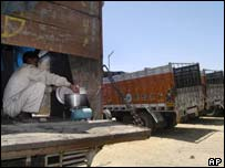 A truck worker cooks during a truckers' strike in Ahmedabad, India in April 2003