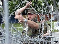 Soldiers putting barbed wire up around the G8 summit venue