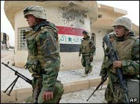 US marines searching Iraqi barracks on edge of Baghdad
