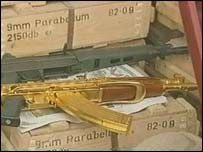 Gold plated Kalashnikov lies next to normal gun