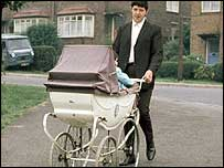 Man pushing a pram