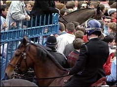 Police horses trying to control the crowds outside the ground