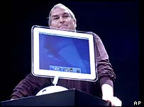 Apple CEO Steve Jobs with Apple's flat-screen iMac computer