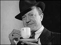 Tommy Handley with a cup of tea, BBC