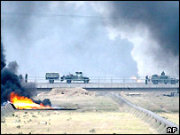 US military pass burning oil pipelines near Baghdad
