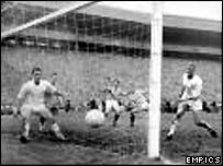 Jimmy Millar scores one of his two goals against Dundee