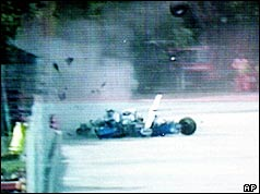 Ayrton Senna's Williams car crashes into the concrete barrier