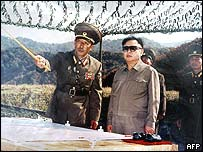 North Korean leader Kim Jong-Il (C) being briefed by field commanders during a military exercise