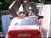 A car being crushed